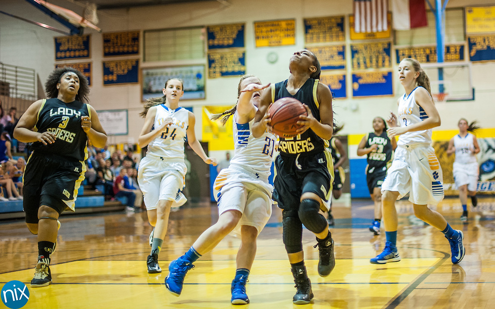 Concord's Danica Ford drives to the basket against Mount Pleasant's Brooklyn Miles Monday night at Mount Pleasant High School. The Lady Spiders won the game 49-31.