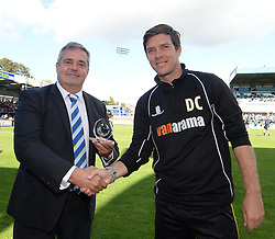 Bristol Rovers Manager, Darrell Clarke presented manger of the month trophy by Bristol Rovers Chairman Nick Higgs  - Photo mandatory by-line: Alex James/JMP - Mobile: 07966 386802 - 04/10/2014 - SPORT - Football - Bristol - Memorial Stadium - Bristol Rovers v Dover - Vanarama Football Conference