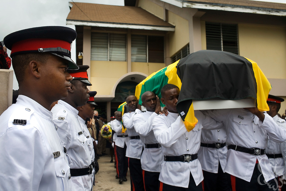 Jamaican Constabulary Force (JCF) officers carry the caskets containing the bodies of slain officers Cornel Grant and Delano Lawrence during their June 15, 2008 funeral at the Hagley Park Road Seventh Day Adventist Church in Kingston, Jamaica. Delano and Grant were gunned down in an ambush in the inner city Trench Town area of Kingston while on patrol May 23, 2008.