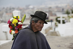 November 2, 2018 - Otavalo, Imbabura, Ecuador - In the cemetery of Otavalo, Samasunchic (Rest in Peace), the indigenous have the rite of sharing food with the deceased next to their graves, in Otavalo, Ecuador, Friday, November 2, 2018. The cemetery has no trails, the familaires walk over the graves to visit their deceased relatives, the cemetery has an area of 2 hectares and it is estimated that more than 3,000 people are buried. (Credit Image: © Franklin JáCome/NurPhoto via ZUMA Press)