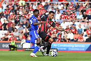 Leicester City Midfielder, Wilfred Ndidi (25) and AFC Bournemouth Forward, Josh King (17) bale for the ball during the Premier League match between Bournemouth and Leicester City at the Vitality Stadium, Bournemouth, England on 15 September 2018.