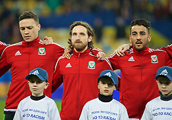 KIEV, UKRAINE - Easter Monday, March 28, 2016: Wales' James Chester, Joe Allen and Neil Taylor line-up before the International Friendly match against Ukraine at the NSK Olimpiyskyi Stadium. (Pic by David Rawcliffe/Propaganda)