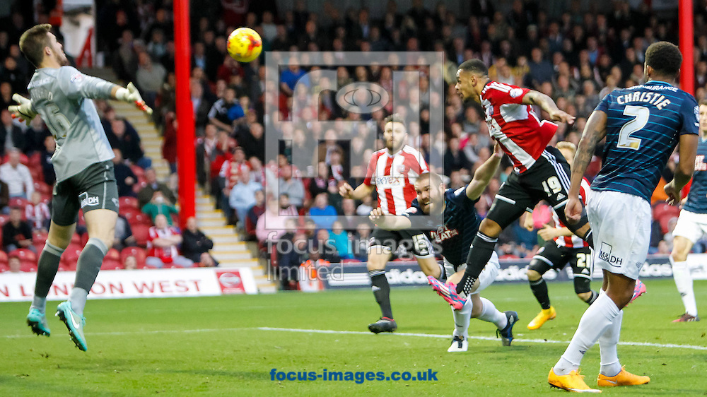 Andre Gray of Brentford heads toward goal during the Sky Bet Championship match between Brentford and Derby County at Griffin Park, London<br /> Picture by Mark D Fuller/Focus Images Ltd +44 7774 216216<br /> 01/11/2014