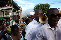 Members of a band make their way through the crowd at a religious parade in Quibdo, the capital of the state of Choco, on October 4, 2006. Choco is a state that has suffered terribly at the hands of both rightwing paramilitaries and leftist rebels over the years, causing many to flee to other parts of Colombia. The Choco is located on the Pacific coast of Colombia and most of the people are black descendants of African slaves. (Photo/Scott Dalton)