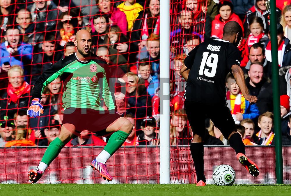 Ryan Babel shoots past Pepe Reina - Photo mandatory by-line: Matt McNulty/JMP - Mobile: 07966 386802 - 29/03/2015 - SPORT - Football - Liverpool - Anfield Stadium - Gerrard's Squad v Carragher's Squad - Liverpool FC All stars Game