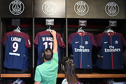 Customers look at items for sale at the Paris Saint-Germain football club's store on the Champs-Elysees avenue on August 3, 2017 in Paris, France. Neymar is set to complete a world-record move to Paris Saint-Germain worth around €402m in fees and wages after telling Barcelona he is leaving. PSG have given the go‑ahead for the forward's buyout fee of €222m to be handed over at the Spanish football federation offices, the protocol required to clear the transfer. Neymar, who flew to Porto on Wednesday for his medical, is expected to be presented in Paris this week. Photo by Eliot Blondet/ABACAPRESS.COM