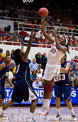 March 20, 2010; Stanford, CA, USA; Stanford Cardinal forward Nnemkadi Ogwumike (30) shoots over UC Riverside Highlanders forward Amber Cox (0) during the first half in the first round of the 2010 NCAA womens basketball tournament at Maples Pavilion.  Stanford defeated UC Riverside 79-47.