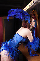 Showgirl checking herself in mirror