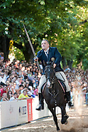 Coja, the second day of the Sinjska Alka (now in its 298th year), in Sinj, Croatia (3 August 2013). The Alka is a knightly tournament dating back to 1715, in which riders compete to spear a small metal ring from a galloping horse. The Alka is inscribed on the UNESCO list of Intangible Cultural Heritage. Pictured here, Mladen Vuckovic, winner of the 298th Coja.