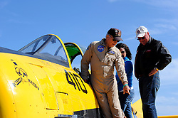 Pilot and owner Dan Dugan shows enthusiasts his T-28B at Saturday and Sunday's  California International Airshow Salinas. The exhibition featured state-of-the-art precision flying from the US Air Force Thunderbirds, Canada's CF-18 demonstration team and the civilian Patriots jet team. Both days of the show highlighted aerobatic routines from Sean Tucker, Jacquie Warda and Kent Pietsch, aerial tributes to flying legends Clay Lacy and Bob Hoover, and plenty of static aircraft displays for the whole family.