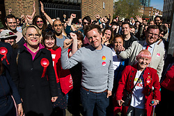 © Licensed to London News Pictures. 03/05/2018. London, UK. Stand up comedian and Labour NEC member EDDIE IZZARD (left front) and Journalist and Labour activist OWEN JONES (centre front) and Labour's parliamentary candidate for the Cities of London & Westminster STEVEN SAXBY (red tie) cheer outside Pimlico Tube Station as part of the 'Unseat Westminster Tory Council'. The gathering was arranged to round up volunteers to speak to Westminster residents who said they would vote for labour. Photo credit : Tom Nicholson/LNP