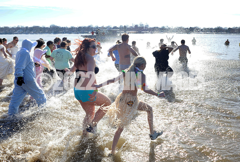 A group of plungers run into the 32 degree Delaware River  during the eighth annual Eastern Polar Bear Plunge to benefit Special Olympics Pennsylvania (SOPA) Saturday January 30, 2016 at Neshaminy State Park in Bensalem, Pennsylvania. (Photo by William Thomas Cain)