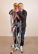 """Damien Hirst Portrait with his artwork.""""St Elmo's Fire"""".2008.Household gloss on plastic skeleton.1700 x 425 x 435 mm.© Damien Hirst. All rights reserved, DACS 2010.Photographed in his Chalford Studio, near Stroud, Gloucestershire"""