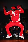 B-Boy in red tracksuit dancing at UK B-Boy Championships 2005.