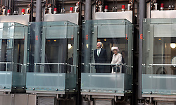 The queen rides a lift at Lloyds of London to the top floor for lunch.<br /> HM The Queen and the Duke of Edinburgh visit  Lloyd's of London, in the City of London, United Kingdom. Thursday, 27th March 2014. Picture by Ben Stevens / i-Images