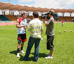 Hong Kong, China - Wednesday, July 25, 2007: Liverpool's Jamie Carragher is interviewed by a television crew after a coaching session with local children at the Siu Sai Wan Sports Ground in Hong Kong. (Photo by David Rawcliffe/Propaganda)