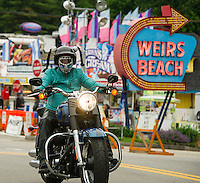 Intermittent riders brings a splash of color through Weirs Beach on Tuesday as we head into the middle of Bike Week.  (Karen Bobotas/for the Laconia Daily Sun)
