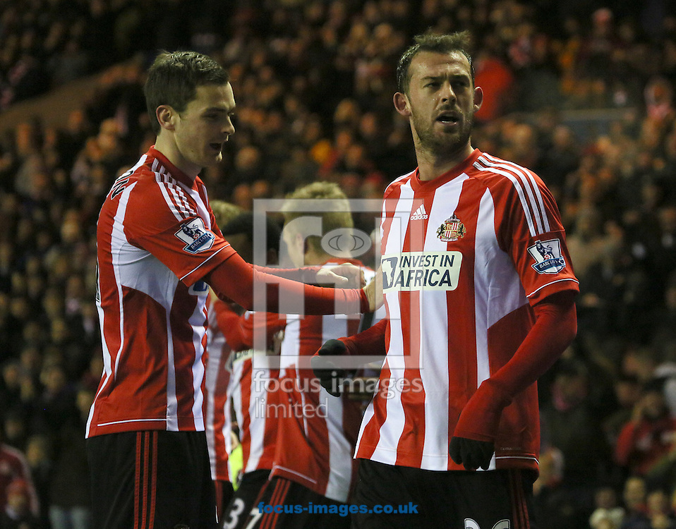 Picture by Paul Gaythorpe/Focus Images Ltd +447771 871632.11/12/2012.Adam Johnson congratulates Steven Fletcher of Sunderland on scoring the second goal against Reading during the Barclays Premier League match at the Stadium Of Light, Sunderland.