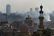 The pyramids of Giza seen through the dust, smoke and haze of Cairo Egypt from the minaret of a mosque. (Supporting image from the project Hungry Planet: What the World Eats.).