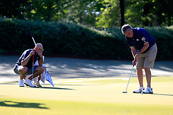 Jon Barry watches Paul Johnson putt during the Chick-fil-A Peach Bowl Challenge at the Oconee Golf Course at Reynolds Plantation, Sunday, May 1, 2018, in Greensboro, Georgia. (Paul Abell via Abell Images for Chick-fil-A Peach Bowl Challenge)