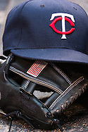 A close up view of the glove and hat of Trevor Plouffe #24 of the Minnesota Twins during a game against the Boston Red Sox on May 17, 2013 at Target Field in Minneapolis, Minnesota.  The Red Sox defeated the Twins 3 to 2.  Photo: Ben Krause
