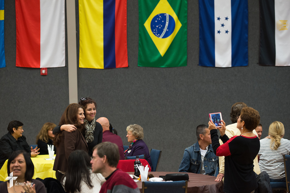 Church members and guests greet each other during a fellowship meal following a monthly bilingual worship on Sunday, Nov. 22, 2015, at Salem Lutheran Church in Springdale, Ark. LCMS Communications/Erik M. Lunsford