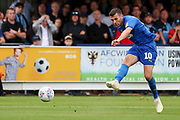 AFC Wimbledon attacker Adam Roscrow (10) with a shot on goal during the EFL Sky Bet League 1 match between AFC Wimbledon and Wycombe Wanderers at the Cherry Red Records Stadium, Kingston, England on 31 August 2019.