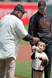 SAN FRANCISCO, CA - APRIL 26:  Former San Francisco Giants center fielder Willie Mays hands a baseball to Cody Harrington of Oakland, CA on the field before the game against the Cleveland Indians at AT&T Park on April 26, 2014 in San Francisco, California. (Photo by Jason O. Watson/Getty Images) *** Local Caption *** Willie Mays; Cody Harrington