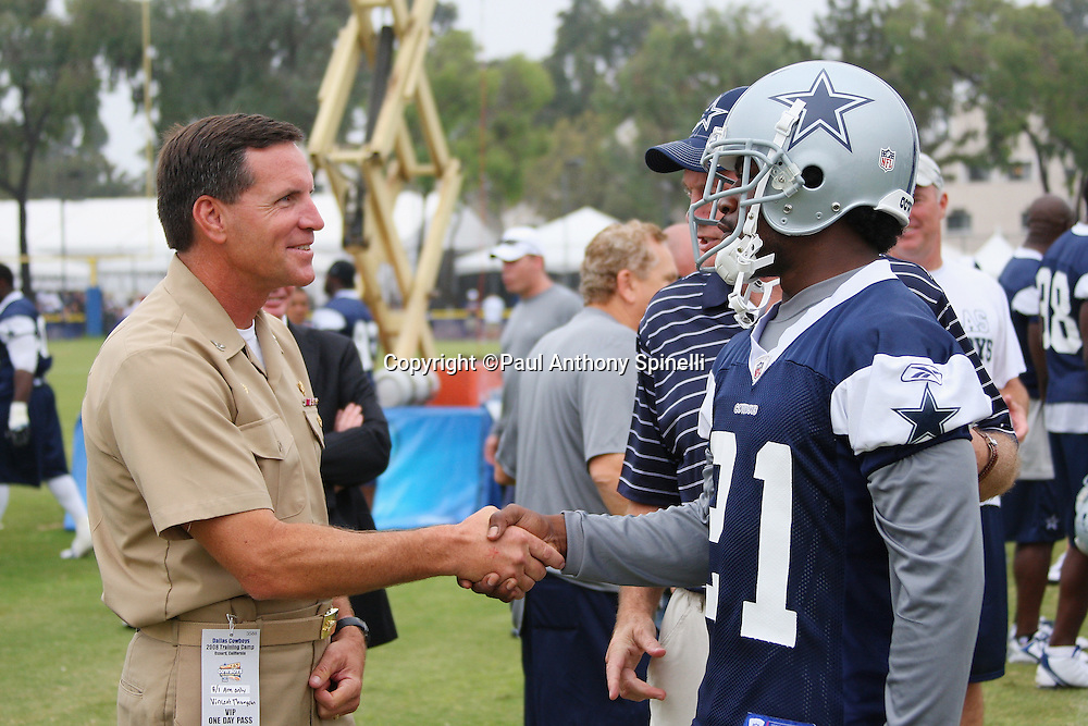"OXNARD, CA - AUGUST 01:  Team Owner, President and General Manager Jerry Jones of the Dallas Cowboys introduces cornerback Adam Jones #21 of the Dallas Cowboys to Captain Brad ""Brick"" Conners (left), the Commanding Officer of the Naval Base Ventura County, during the 2008 Dallas Cowboys Training Camp at River Ridge Field in Oxnard, California on August 1, 2008. ©Paul Anthony Spinelli *** Local Caption *** Jerry Jones;Brad Conners;Adam Jones"