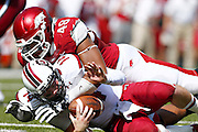 FAYETTEVILLE, AR - OCTOBER12:  Connor Shaw #14 of the South Carolina Gamecocks is sacked by Deatrich Wise Jr. #48 of the Arkansas Razorbacks at Razorback Stadium on October 12, 2013 in Fayetteville, Arkansas.  (Photo by Wesley Hitt/Getty Images) *** Local Caption *** Conner Shaw; Deatrich Wise Jr.