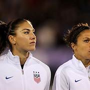 USA goalkeeper Hope Solo (left), and team mate Carli Lloyd during team National Anthems before the USA Vs Colombia, Women's International friendly football match at the Pratt & Whitney Stadium, East Hartford, Connecticut, USA. 6th April 2016. Photo Tim Clayton