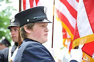 Merrick Fire Department Empire Hose Company 3 Juniors firefighter members at Merrick Memorial Day Parade and Ceremony on May 28, 2012, on Long Island, New York, USA. America's war heroes are honored on this National Holiday.  The E. H. Co 3's Junior firefighters members are boys and girls from age 13-18.