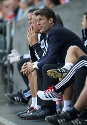 SWANSEA, WALES - Saturday, September 22, 2012: Swansea City's manager Brian Laudrup watches his side lose 3-0 to Everton during the Premiership match at the Liberty Stadium. (Pic by David Rawcliffe/Propaganda)