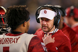 Nov 23, 2018; Morgantown, WV, USA; Oklahoma Sooners head coach Lincoln Riley talks with Oklahoma Sooners quarterback Kyler Murray (1) during the fourth quarter against the West Virginia Mountaineers at Mountaineer Field at Milan Puskar Stadium. Mandatory Credit: Ben Queen-USA TODAY Sports