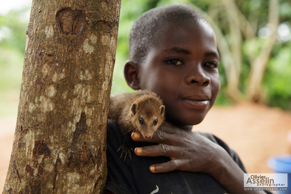 "A boy and his pet ""mangouste"" in Man, Cote d'Ivoire on Wednesday July 24, 2013."