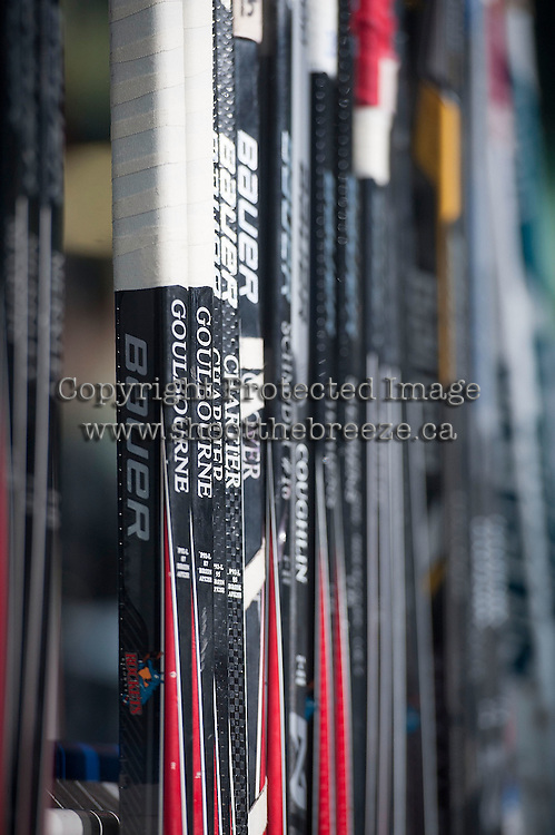 KELOWNA, CANADA - NOVEMBER 21: Kelowna Rockets sticks stand on the bench before the game against the Portland Winterhawks on November 21, 2014 at Prospera Place in Kelowna, British Columbia, Canada.  (Photo by Marissa Baecker/Shoot the Breeze)  *** Local Caption *** sticks;