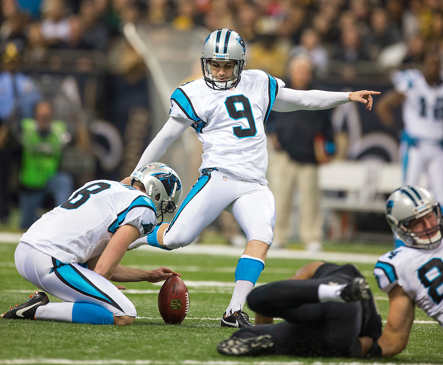 NEW ORLEANS, LA - DECEMBER 30:  Graham Gano #9 of the Carolina Panthers kicks a extra point against the New Orleans Saints at Mercedes-Benz Superdome on December 30, 2012 in New Orleans, Louisiana.  The Panthers defeated the Saints 44-38.  (Photo by Wesley Hitt/Getty Images) *** Local Caption *** Cam Newton