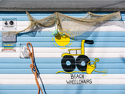 Pictured: Beach Wheelchairs Charity opening. 23 March 2019  Pictured: Charity Beach Wheelchairs celebrates opening of a new storage area in the harbour. Beach Wheelchairs is a Scottish Charity which has helped nearly 500 individuals to get on the beaches at North Berwick. It relies on volunteers to help people access the beaches. The colourful beach wheelchair hut in the harbour area.<br /> Sally Anderson / EdinburghElitemedia.co.uk<br /> Reproduction fee payable to<br /> Edinburgh Elite Media