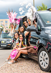 Pictured: Edinburgh Festival Fringe, Edinburgh, Scotland, United Kingdom, 07 August 2019 . Lady Boys of Bangkok photocall. Businessman Jamie Bowes leads a fundraiser in which he will donate £10 to Edinburgh taxi drivers children's charities for every Lady Boy who manages to squeeze into an Edinburgh black cab as the performers celebrate their 21st year on the Edinburgh Fringe.<br /> Sally Anderson | EdinburghElitemedia.co.uk