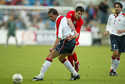 OSLO, NORWAY - Thursday, May 27, 2004:  Wales' Chris Llewelyn is blocked by Norway's Claus Lundekvam during the International Friendly match at the Ullevaal Stadium, Oslo, Norway. (Photo by David Rawcliffe/Propaganda)