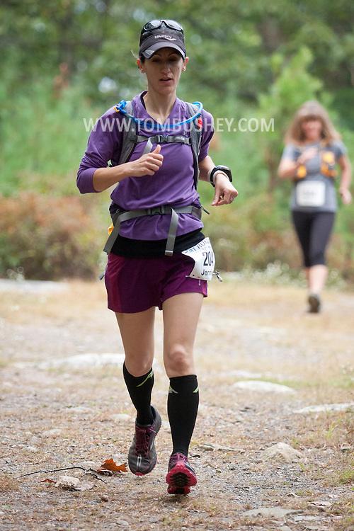 Kerhonkson, New York - Jennifer Finnegan runs through Minnewaska State Park Preserve during the Shawangunk Ridge Trail Run/Hike 20-mile race on Sept. 20, 2014.