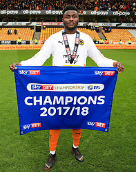 Free to use courtesy of Sky Bet - Bright Enobakhare of Wolverhampton Wanderers celebrates after lifting the Sky Bet Championship 2017/18 league trophy - Mandatory by-line: Matt McNulty/JMP - 28/04/2018 - FOOTBALL - Molineux - Wolverhampton, England - Wolverhampton Wanderers v Sheffield Wednesday - Sky Bet Championship