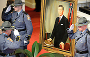 An honor guard stands watch near a portrait of Georgia Gov. Carl Sanders during a memorial service for him at Second Ponce de Leon Baptist Church on Saturday, Nov. 22, 2014, in Atlanta. Six living Georgia governors attended the service included current Gov. Nathan Deal, and former governors Roy Barnes, Jimmy Carter, Joe Frank Harris, Sonny Perdue, and Zell Miller, along with business and other political leaders. Photo by David Tulis