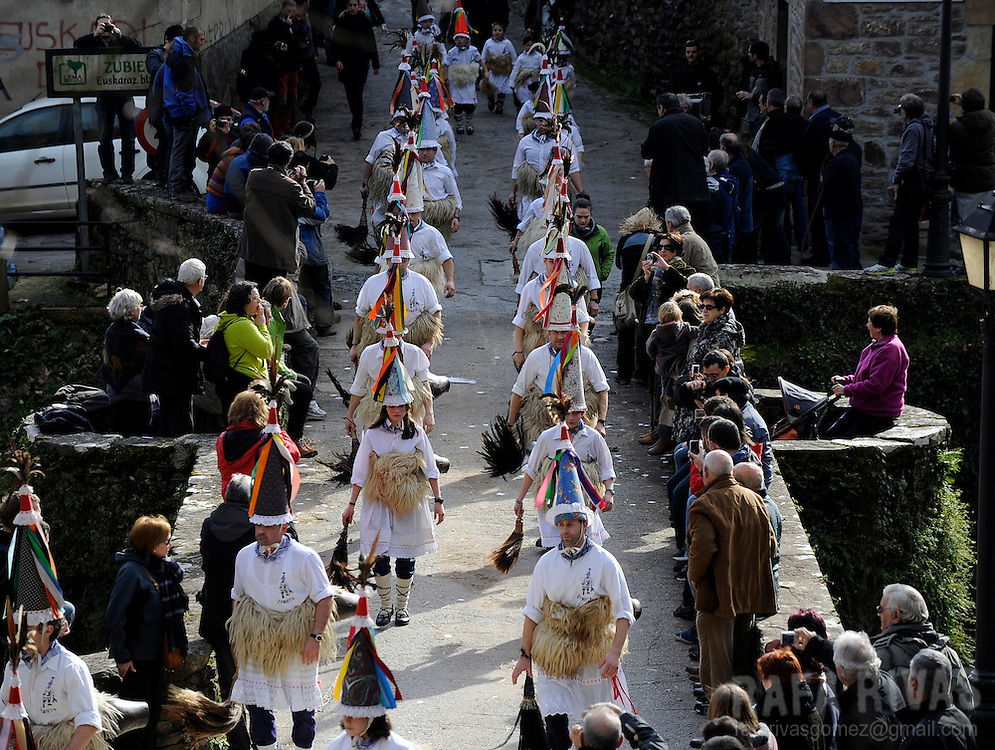 "A group of  ""Joaldunak"" (""those who play the bell"") parade carrying big cowbells tied to their backs during the ancient carnival of Zubieta, in the northern Spanish province of Navarra province, on January 29, 2013."