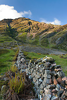 Stone wall running up a hillside in Glen Coe Scotland