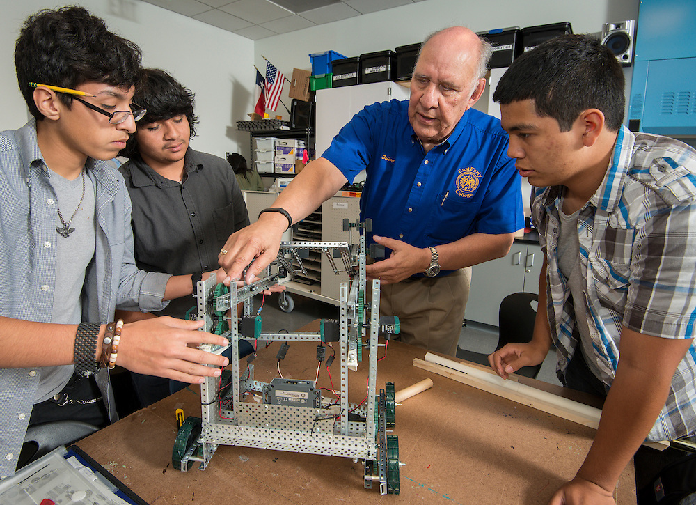 Samuel Saenz works with his research and development students at East Early College High School School, April 22, 2014.