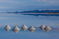 Piles of salt made by salt miners, dry during the rainy season in the Salar de Uyuni, Potosi, Bolivia