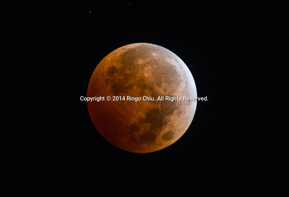 The Blood Moon, created by the full moon passing into the shadow of the earth during a total lunar eclipse, is seen from Los Angeles California on Wednesday morning, October 8, 2014. (Photo by Ringo Chiu/PHOTOFORMULA.com)