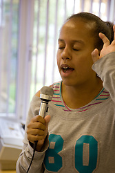 Day Service user with learning disabilities singing,