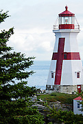 The tower of the Head Harbor Light (also called the East Quoddy Light) is painted a cheerful red and white.